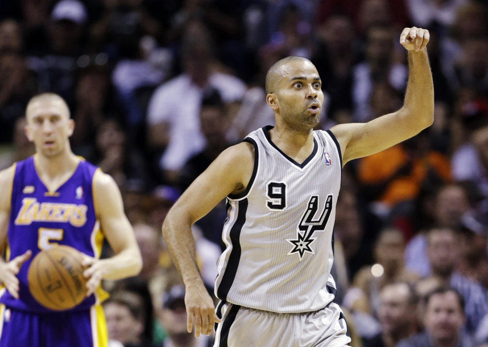 San Antonio Spurs' Tony Parker (9), of France, asks an official for a goaltending call during the first half of Game 1 of their first-round NBA playoff basketball series against the Los Angeles Lakers, Sunday, April 21, 2013, in San Antonio. (AP Photo/Eric Gay)