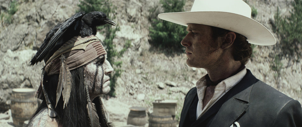 """Photo -  """"THE LONE RANGER""""  L to R: Johnny Depp as Tonto and Armie Hammer as The Lone Ranger  Ph: Peter Mountain  ©Disney Enterprises, Inc. and Jerry Bruckheimer Inc.  All Rights Reserved."""