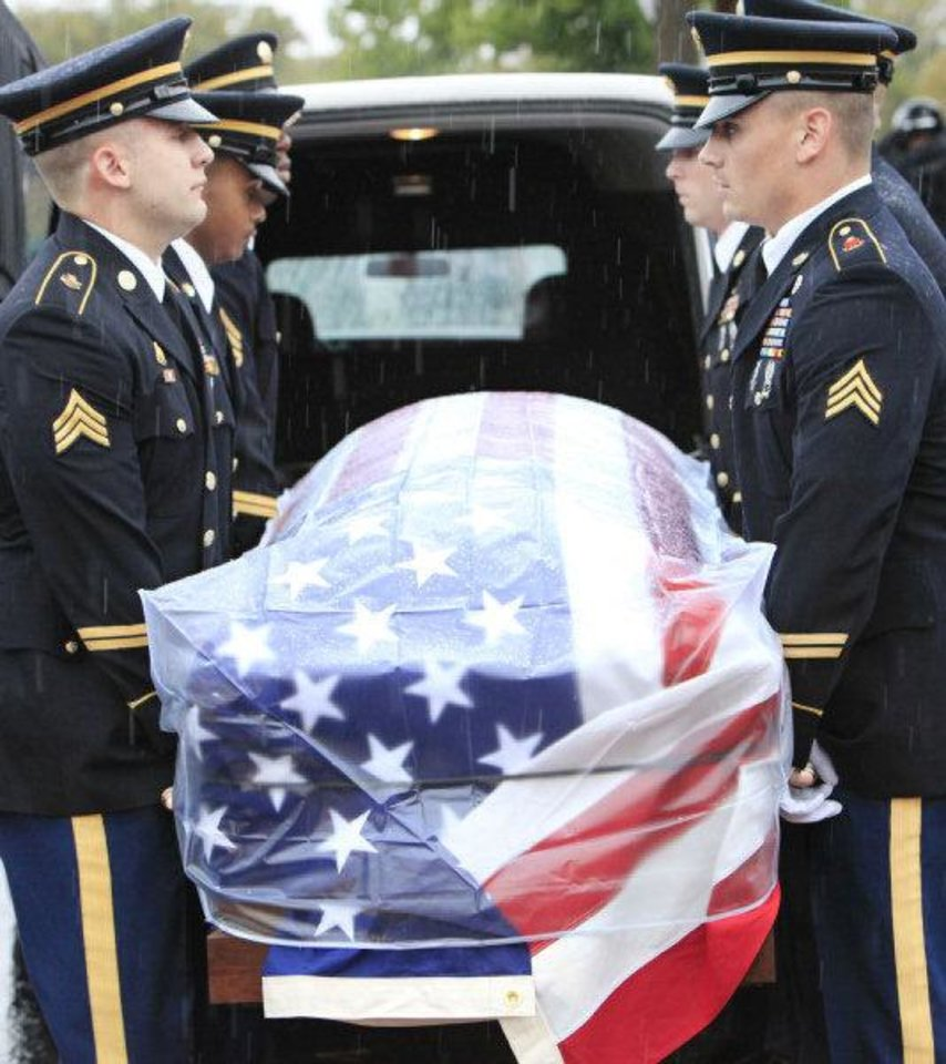 Photo - Honor guard places the flag draped coffin in a hearse during the funeral for 2nd Lt Jered Ewy, 33, of Edmond, at Henderson Hills Baptist Church.  David McDaniel - THE OKLAHOMAN