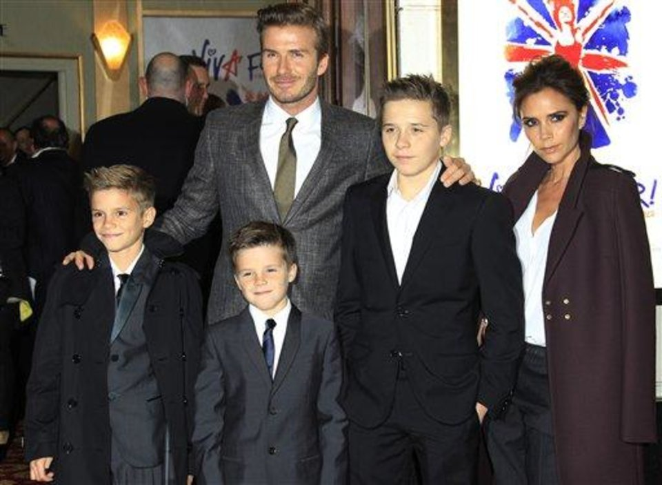 Photo - The Beckham family arrive for Viva Forever! Press Night, a musical based on the songs of the Spice Girls, at the Piccadilly Theatre in central London, Tuesday, Dec. 11, 2012. (Photo by Joel Ryan/Invision/AP)