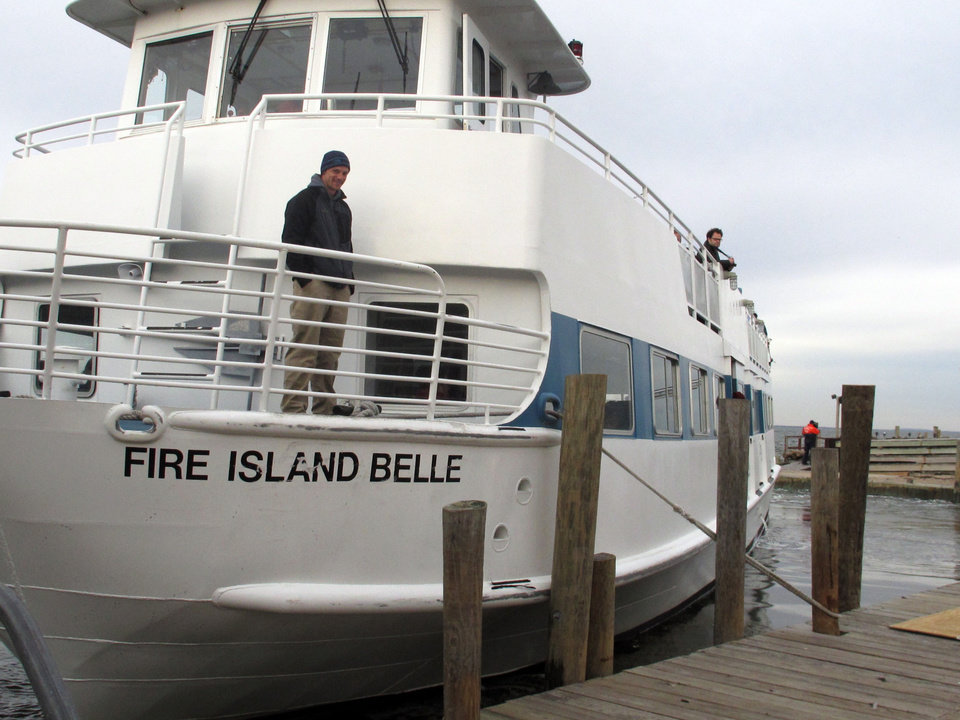 Photo -   In this Friday, Nov. 16, 2012 photo, the ferry Fire Island Belle leaves the dock with passengers visiting Ocean Beach, N.Y. Residents of the Fire Island community were allowed to visit to assess damage from Superstorm Sandy. (AP Photo/Frank Eltman)
