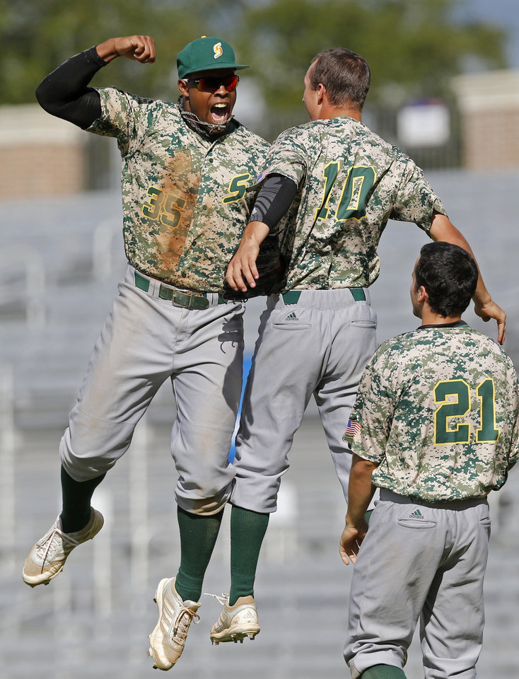 Photo - Southeastern Louisiana's Andrew Godbold, left, celebrates with teammate Kyle Cedotal (10) after throwing out Bryant's Dan Cellucci at the plate to end the 10th inning and win during an NCAA college baseball regional tournament game in Baton Rouge, La., Saturday, May 31, 2014. Southeastern Louisiana won 2-1. (AP Photo/Derick Hingle)