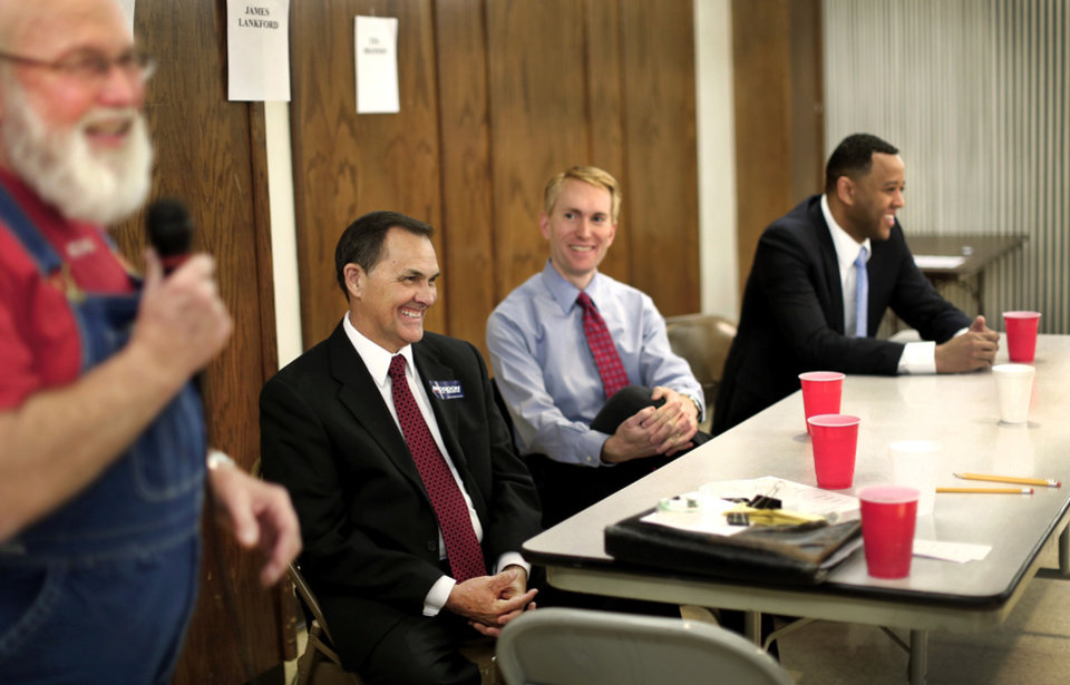 U.S. Senate candidates Brogdon, Lankford and Shannon laugh at one of the comments made by debate moderator before debate begins on Wednesday, Monday, April 16, 2014. Photo by Jim Beckel, The Oklahoman