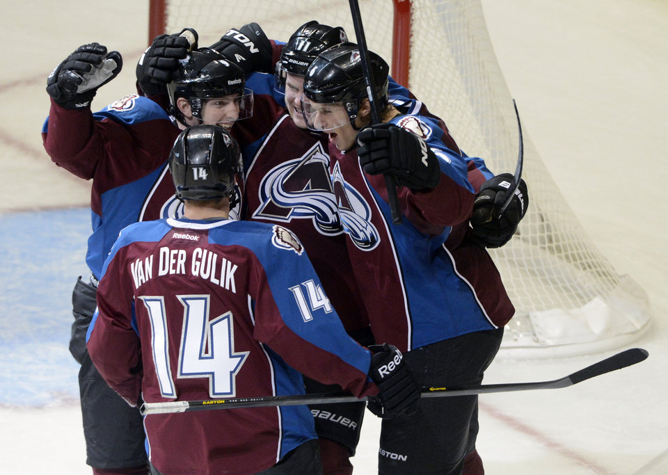 Photo - Colorado Avalanche's David Van Der Gulik (14), Matt Duchene, left, Jamie McGinn, center, and Erik Johnson celebrate McGinn's go-ahead goal in the second period of an NHL hockey game against the Edmonton Oilers in Denver, Saturday, Feb. 13, 2013. The Avalanche won 3-1. (AP Photo/The Denver Post, Andy Cross)  MAGAZINES OUT; TV OUT; INTERNET OUT; NO SALES