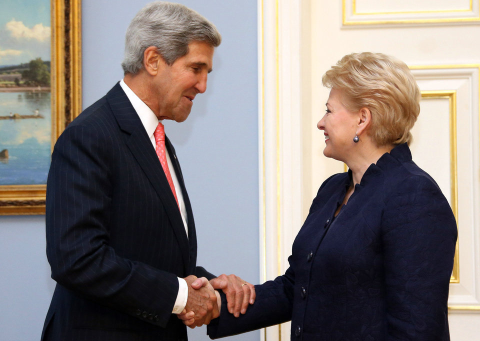 Photo - This photo made available by the Lithuanian Presidential Press Service shows United States Secretary of State John Kerry,left, and Lithuania's President Dalia Grybauskaite shaking hands prior to their meeting at the President palace in Vilnius, Lithuania,  , Sept. 7, 2013. Kerry is in Europe courting international support for a possible U.S. strike on the Syrian regime for its alleged use of chemical weapons.  (AP Photo/Presidential Press Service, Dzoja Borysaite)