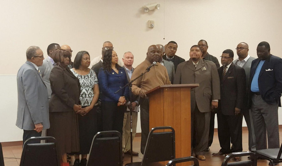 Photo - Members of the Concerned Clergy for Spiritual Renewal talk about voter education activities at a news conference on Thursday at Fairview Baptist Church, 1700 NE 7. [Photo by Carla Hinton, The Oklahoman]