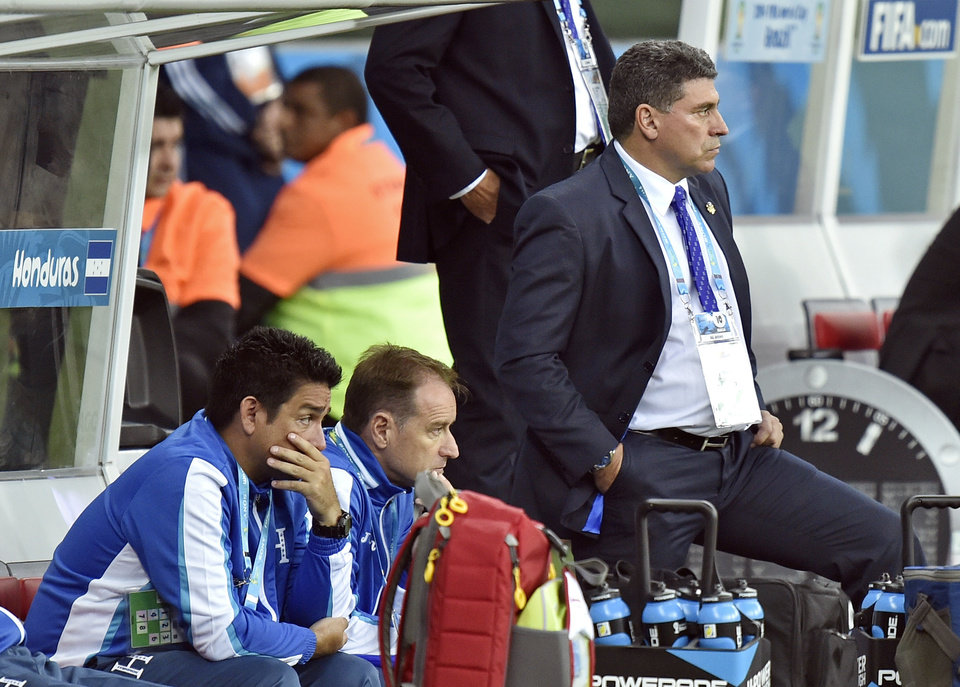 Photo - Honduras' head coach Luis Suarez, right, stands by his team's bench during the group E World Cup soccer match between France and Honduras at the Estadio Beira-Rio in Porto Alegre, Brazil, Sunday, June 15, 2014. France defeated Honduras 3-0.  (AP Photo/Martin Meissner)