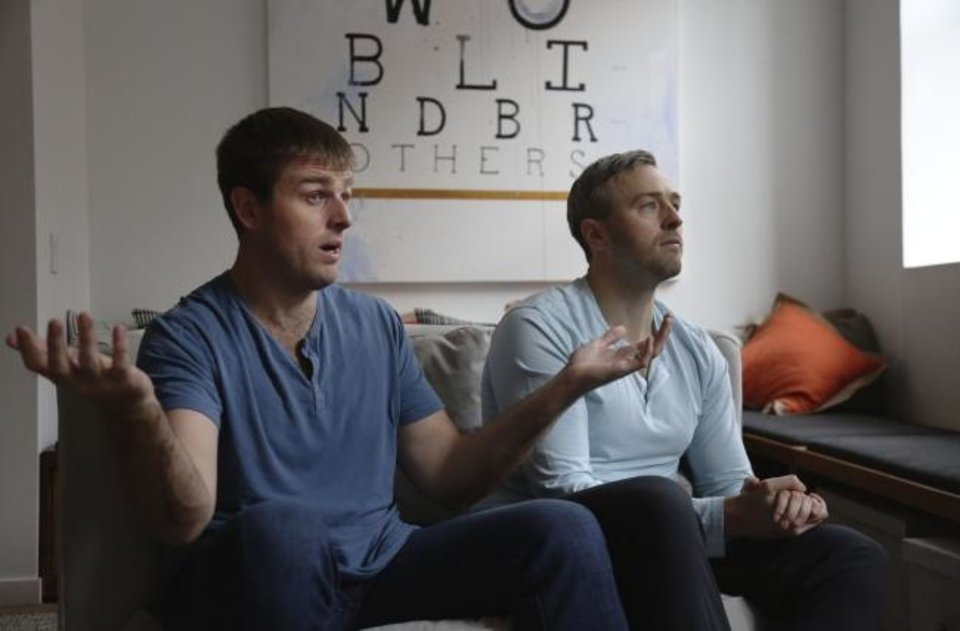Photo -  Brothers, Bryan, left, and Bradford Manning, discuss the origins of their clothing company, Two Blind Brothers, in their New York City loft. [AP Photo/Jessie Wardarski]