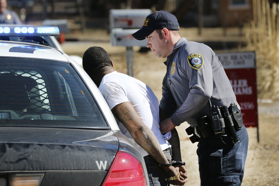 Photo - Oklahoma City police arrest a man near NW 12 and Villa Avenue after a brief chase  near Hawthorne Elementary School. The school was placed on lockdown during the chase. Photo By Steve Gooch, The Oklahoman  Steve Gooch - The Oklahoman
