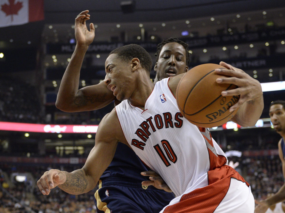 Toronto Raptors' DeMar DeRozan drives the ball against New Orleans Pelicans' Al-Farouq Aminu during first quarter NBA action in Toronto, Monday, Feb. 10, 2014. (AP Photo/The Canadian Press, Frank Gunn)