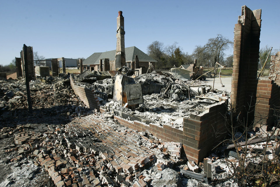 Photo - A few bricks are all that remain of this home on the SW corner of Hiwasee Rd. and Reno in Choctaw, Okla., Saturday, April 11, 2009 after high winds and wildfire consumed it and dozens of other homes in the area Thursday evening. Photo by Paul Hellstern, The Oklahoman