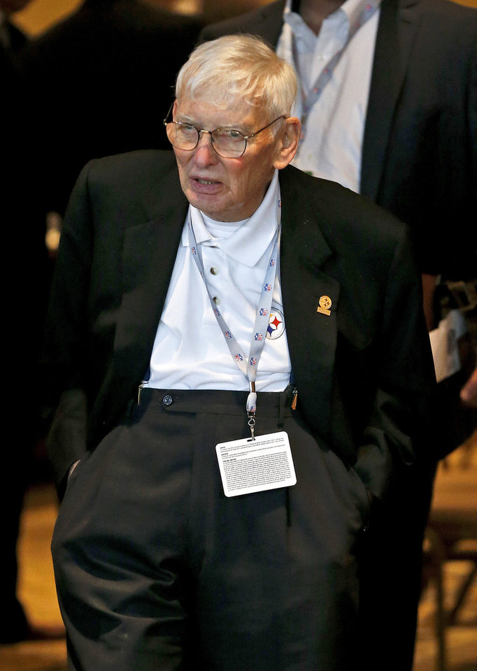 Photo - Pittsburgh Steelers chairman Dan Rooney walks out after a morning session at the annual NFL football meetings at the Arizona Biltmore, Tuesday, March 19, 2013, in Phoenix. (AP Photo/Ross D. Franklin)