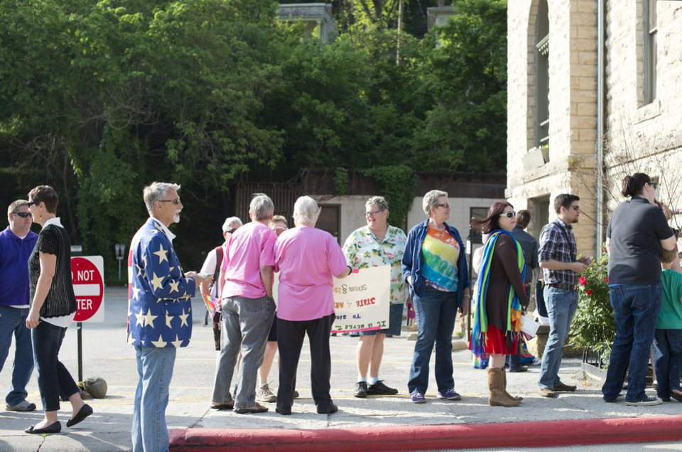 Photo - A line forms at the Carroll County Courthouse of same-sex couples waiting to apply for a marriage license Saturday, May 10, 2014, in Eureka Springs, Ark. A judge overturned amendment 83 Friday, which banned same-sex marriage in the state of Arkansas. (AP Photo/Sarah Bentham)