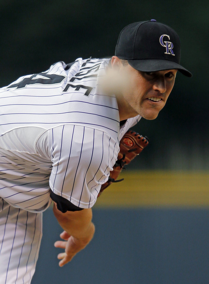 Photo - Colorado Rockies starting pitcher Matt Belisle throws to a Cincinnati Reds batter during the first inning of a baseball game Friday, Aug. 15, 2014, in Denver. (AP Photo/Jack Dempsey)