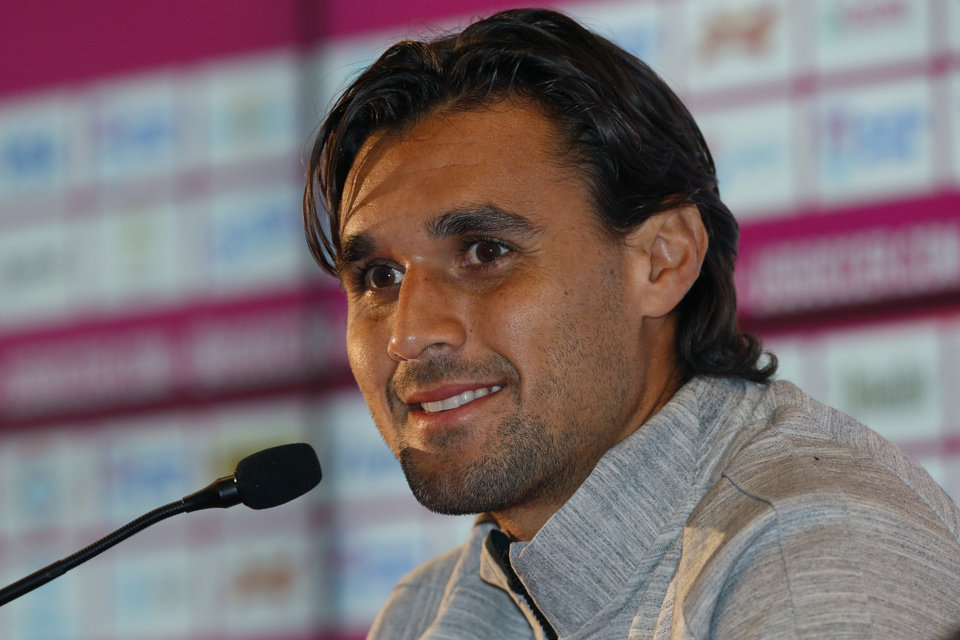 United States\' Chris Wondolowski talks during a press conference before a training session in Sao Paulo, Brazil, Friday, June 20, 2014. The U.S. will play against Portugal in group G of the 2014 soccer World Cup on June 22. (AP Photo/Julio Cortez)