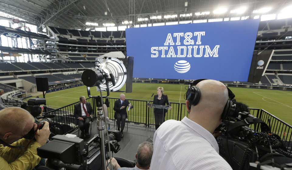 Photo - AT&T senior vice president Cathy Coughlin, center right, speaks as Arlington Mayor Robert Cluck and Dallas Cowboys owner Jerry Jones look on during news conference announcing the naming of the new AT&T Stadium and home of the Dallas Cowboys Thursday, July 25, 2013, in Arlington, Texas. The terms of the naming deal were not released.  (AP Photo/LM Otero)