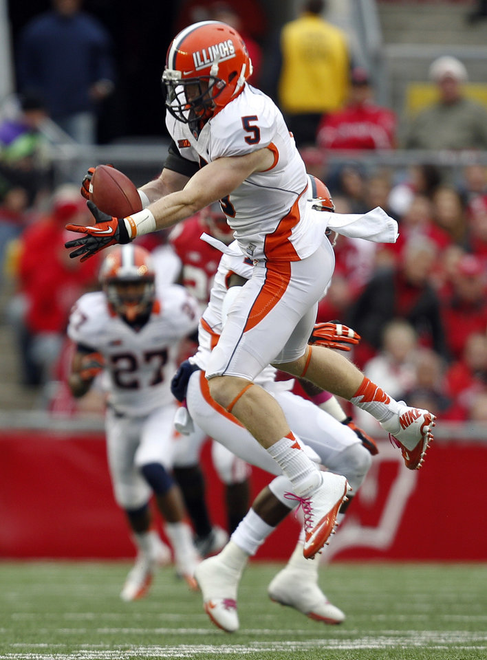 Illinois defensive back Steve Hull (5) makes a interception against Wisconsin during the first half of an NCAA college football game on Saturday, Oct. 6, 2012, in Madison, Wis. (AP Photo/Andy Manis)