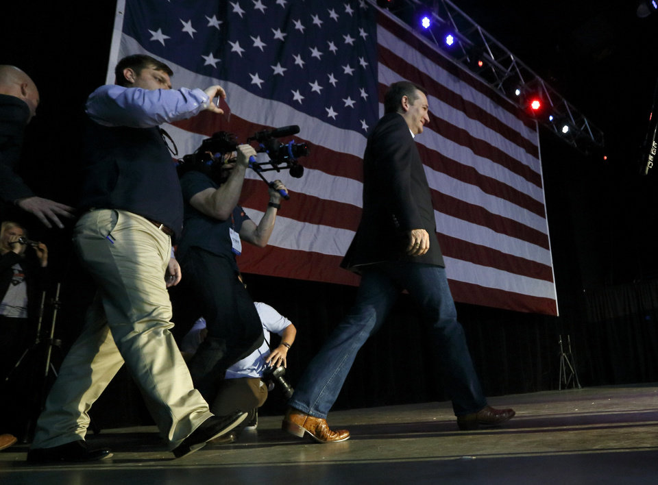 Photo - Republican presidential candidate Ted Cruz comes out to speak at the Chevy Bricktown Event Center as part of the Oklahoma City Courageous Conservatives Rally on Sunday, Feb. 28, 2016 in Oklahoma City, Okla.  Photo by Steve Sisney, The Oklahoman