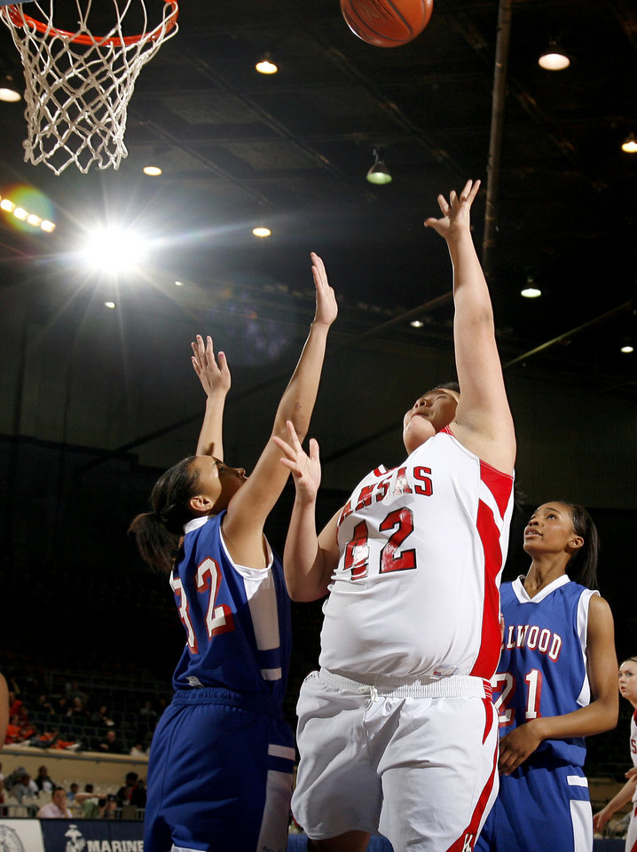Photo - Kansas' Brooke Panther (42) shoots in front of Quira Demery (32) and JohVonna Mitchell (21) during the girls 3A semifinal between MIillwood and Kansas at the State Fair Arena, Friday, March 13, 2009, in Oklahoma City. PHOTO BY SARAH PHIPPS, THE OKLAHOMAN