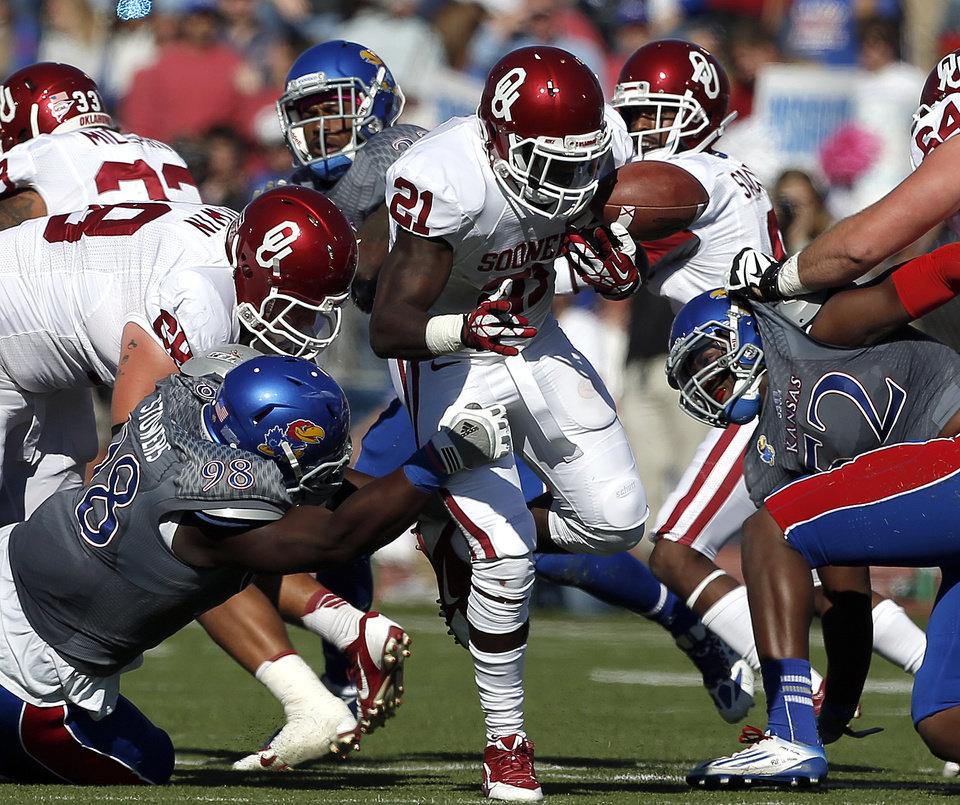 OU's Keith Ford (21) fumbles during of the college football game between the University of Oklahoma Sooners (OU) and the University of Kansas Jayhawks (KU) at Memorial Stadium in Lawrence, Kan., Saturday, Oct. 19, 2013. OU won 34-19. Photo by Sarah Phipps, The Oklahoman