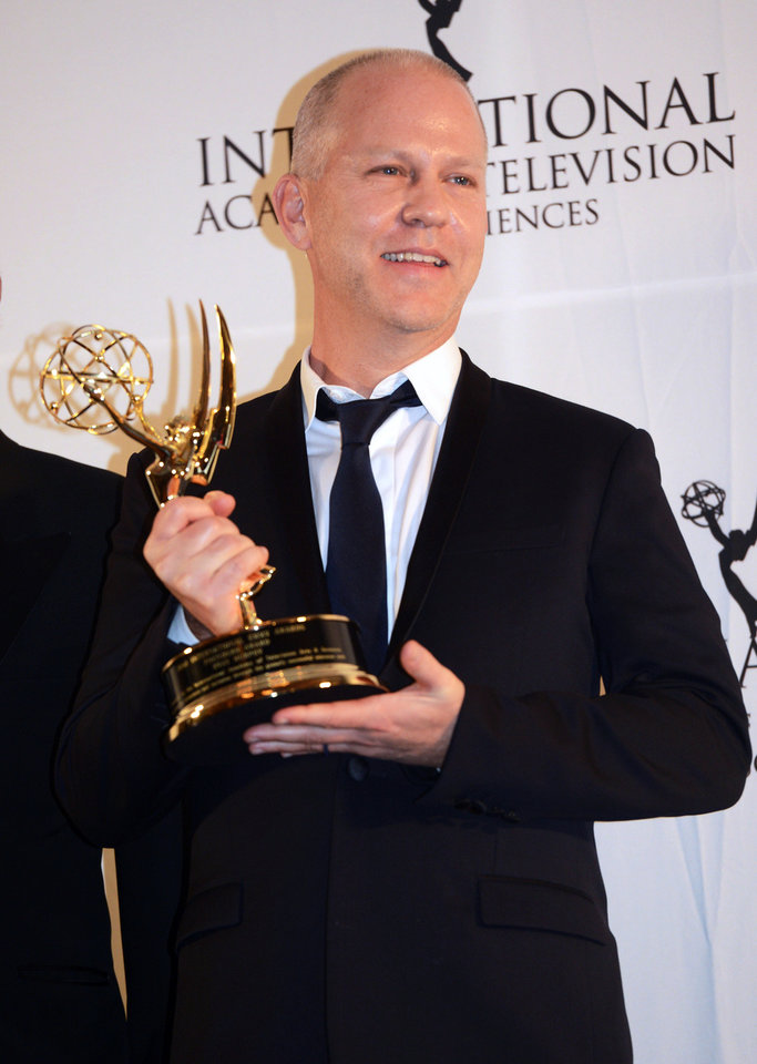 Photo -   Ryan Murphy poses with his trophy after winning the Founders Award at the 40th International Emmy Awards, Monday, Nov. 19, 2012 in New York. (AP Photo/Henny Ray Abrams)