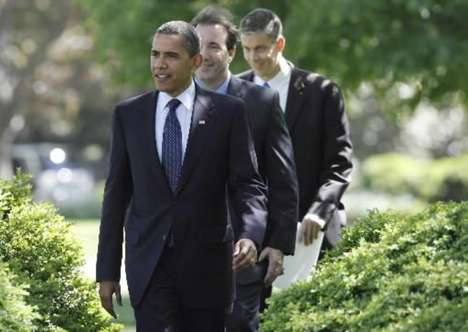 Photo - President Barack  Obama walks with 2009 National Teacher of the Year Anthony Mullen of Greenwich, Conn., center, and Education Secretary Arne  Duncan, rear, to the Rose Garden of the White House in Washington, Tuesday, April 28, 2009. (AP Photo/Charles Dharapak)