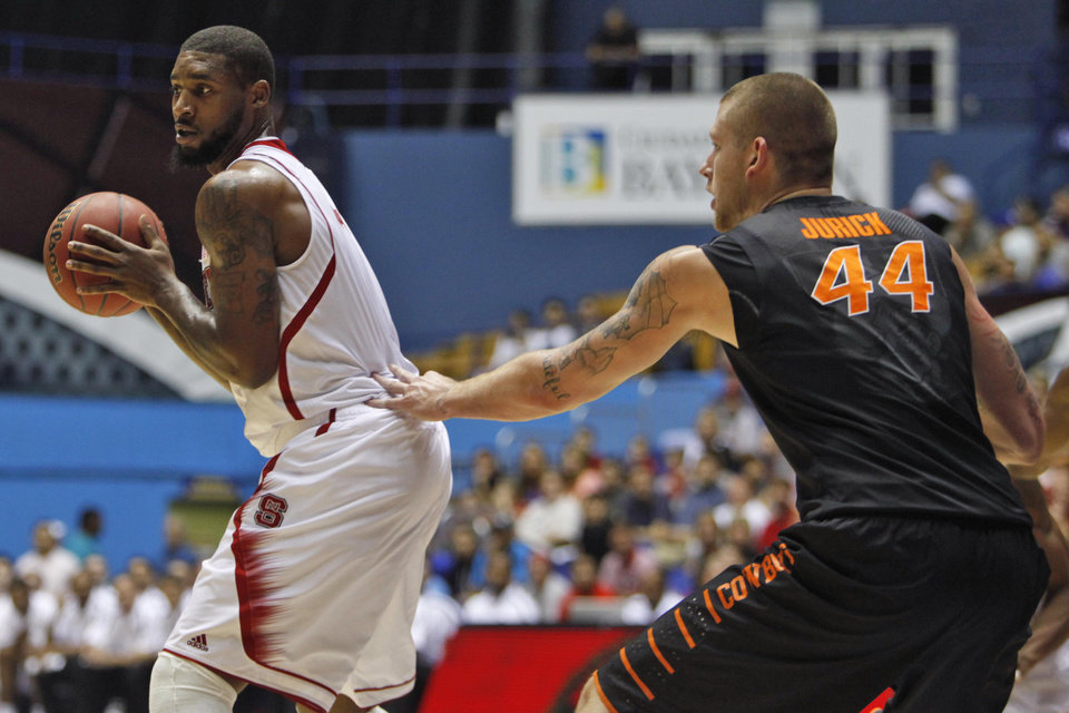 Photo -   Oklahoma State's Phillip Jurick, right, pressures NC State's Richard Howell during a NCAA college basketball game in Bayamon, Puerto Rico, Sunday, Nov. 18, 2012. (AP Photo/Ricardo Arduengo