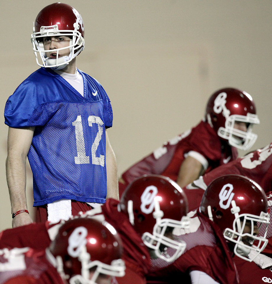 Photo - OU / COLLEGE FOOTBALL / SPRING PRACTICE: Oklahoma Sooners quarterback Landry Jones looks down the offensive line during practice at the Everest Training Facility on the University of Oklahoma campus in Norman on Monday, March 8, 2010. Photo by John Clanton, The Oklahoman ORG XMIT: KOD