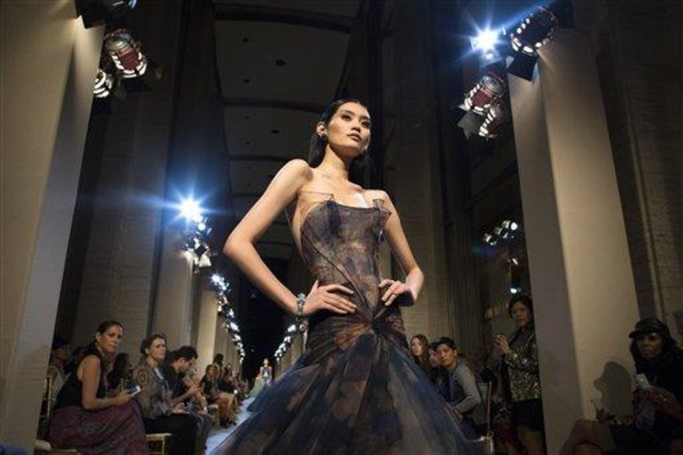 Photo - The Zac Posen Spring 2013 collection is modeled during Fashion Week in New York, Sunday, Sept. 9, 2012. (AP Photo/John Minchillo)