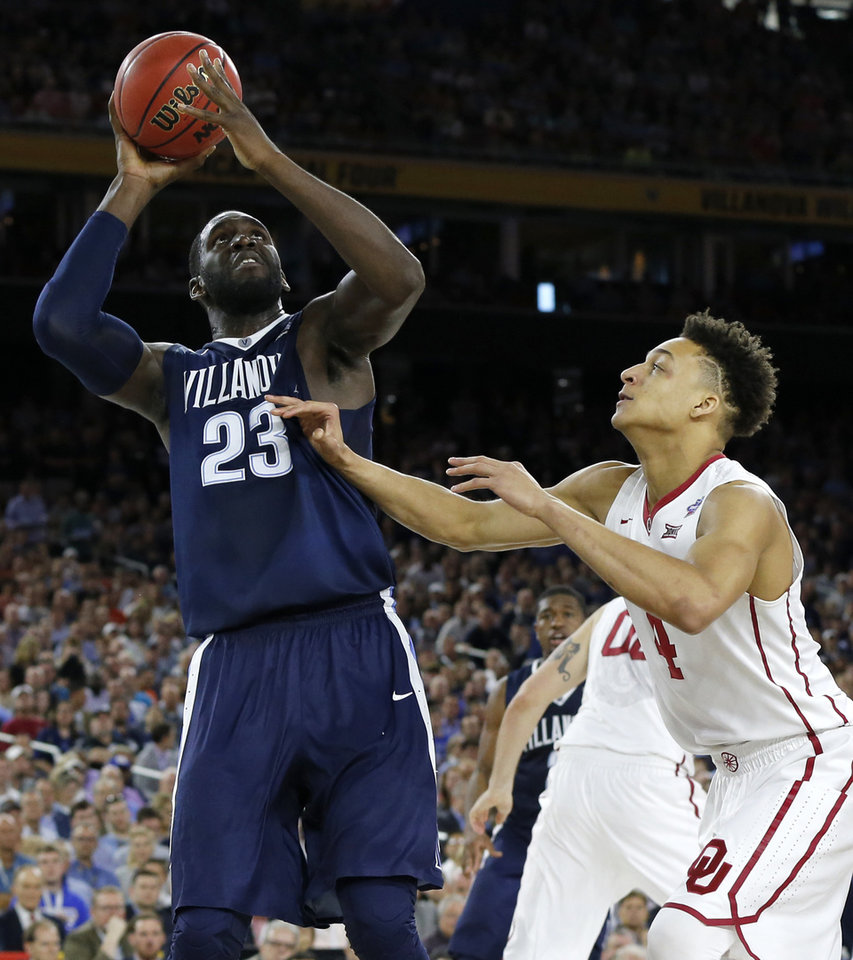 Photo - Villanova's Daniel Ochefu (23) puts up a shot beside Oklahoma's Jamuni McNeace (4) during the national semifinal between the Oklahoma Sooners (OU) and the Villanova Wildcats in the Final Four of the NCAA Men's Basketball Championship at NRG Stadium in Houston, Saturday, April 2, 2016. Photo by Nate Billings, The Oklahoman