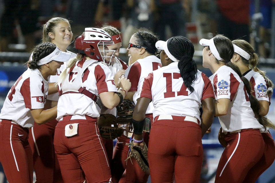 Photo - Oklahoma celebrates winning the fourth game of the Women's College World Series between the University of Oklahoma (OU) and Alabama at USA Softball Hall of Fame Stadium in Oklahoma City, Thursday, May 30, 2019. [Bryan Terry/The Oklahoman]