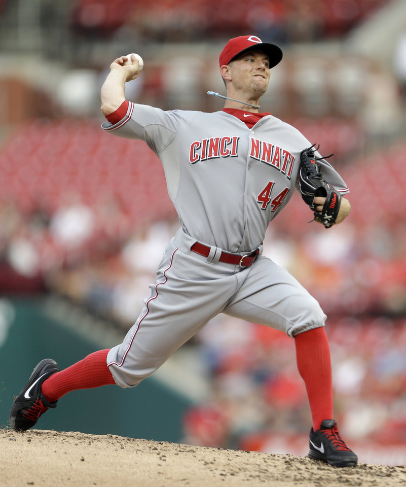 Photo - Cincinnati Reds starting pitcher Mike Leake throws during the first inning of a baseball game against the St. Louis Cardinals Monday, Aug. 26, 2013, in St. Louis. (AP Photo/Jeff Roberson)