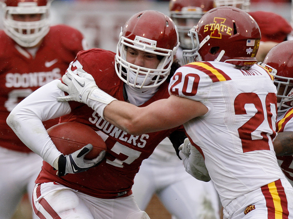 Oklahoma\'s Trent Ratterree (47) fights off Iowa State\'s Jake Knott (20) during a college football game between the University of Oklahoma Sooners (OU) and the Iowa State University Cyclones (ISU) at Gaylord Family-Oklahoma Memorial Stadium in Norman, Okla., Saturday, Nov. 26, 2011. Photo by Bryan Terry, The Oklahoman