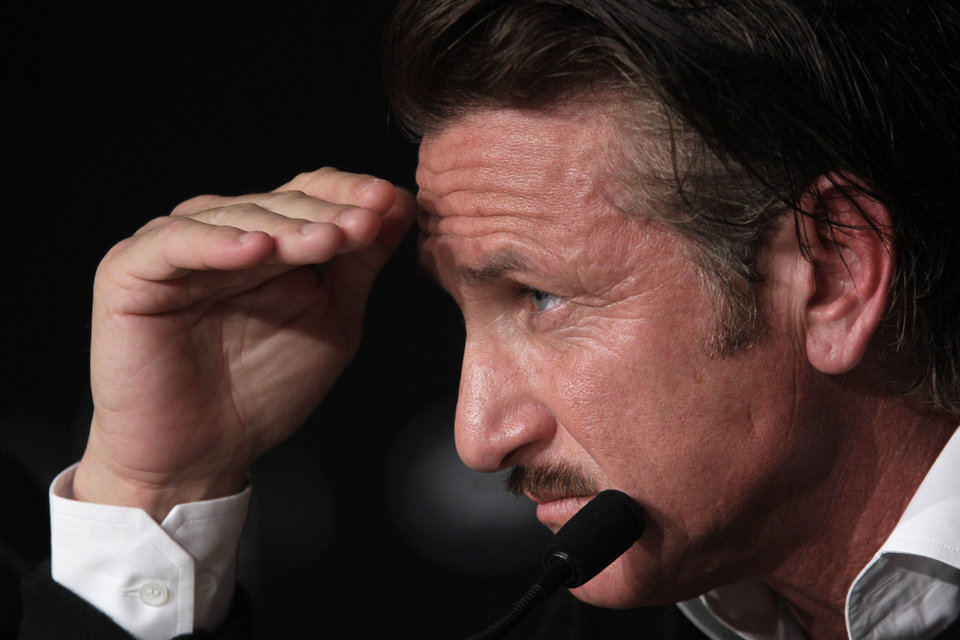 Photo -   Actor Sean Penn gestures during a press conference for the Haiti Carnival charity event at the 65th international film festival, in Cannes, southern France, Friday, May 18, 2012. (AP Photo/Francois Mori)