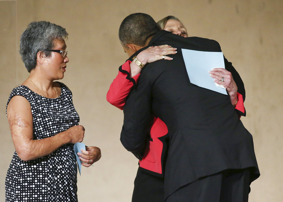 Photo - President Barack Obama greets Alson Crowther and Ling Young during the dedication ceremony at the National September 11 Memorial Museum in New York on Thursday, May 15, 2014. (AP Photo/The New York Times,  Chang W. Lee, Pool)