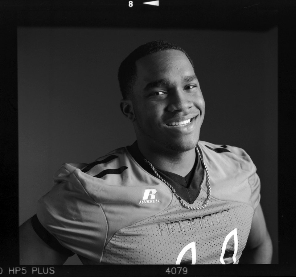 Photo - All-State high school football player Dominique Alexander of Booker T. Washington poses for a photo in Oklahoma City,  Wednesday, Dec. 19, 2012. Photo by Nate Billings, The Oklahoman