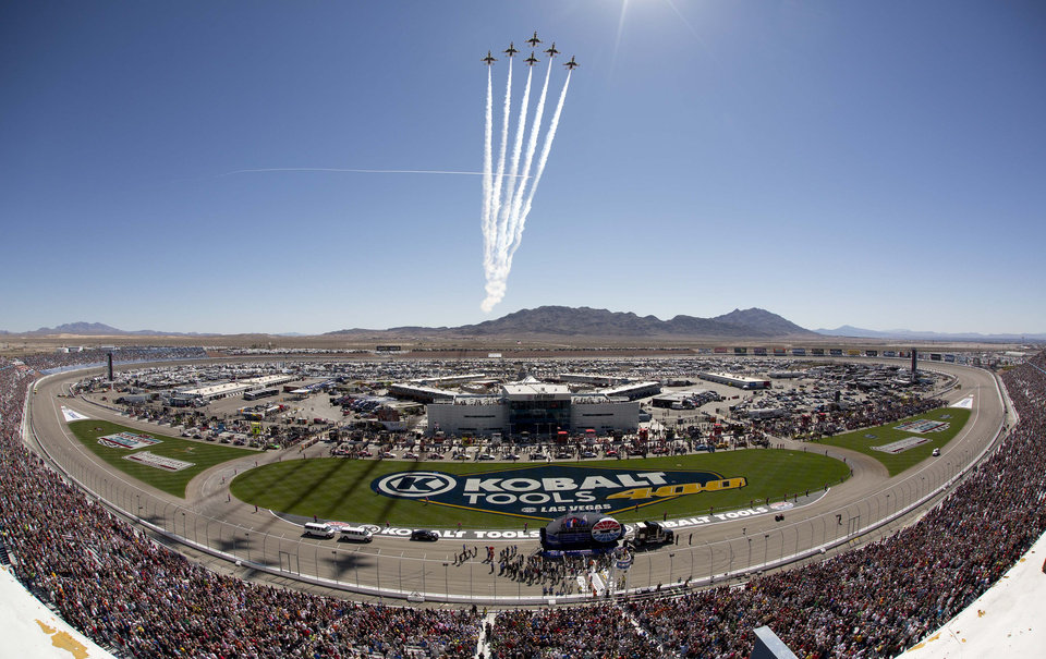 The United States Air Force Thunderbirds performs a fly-by during the national anthem before the NASCAR Sprint Cup Series auto race, Sunday, March 10, 2013 in Las Vegas. (AP Photo/Julie Jacobson)