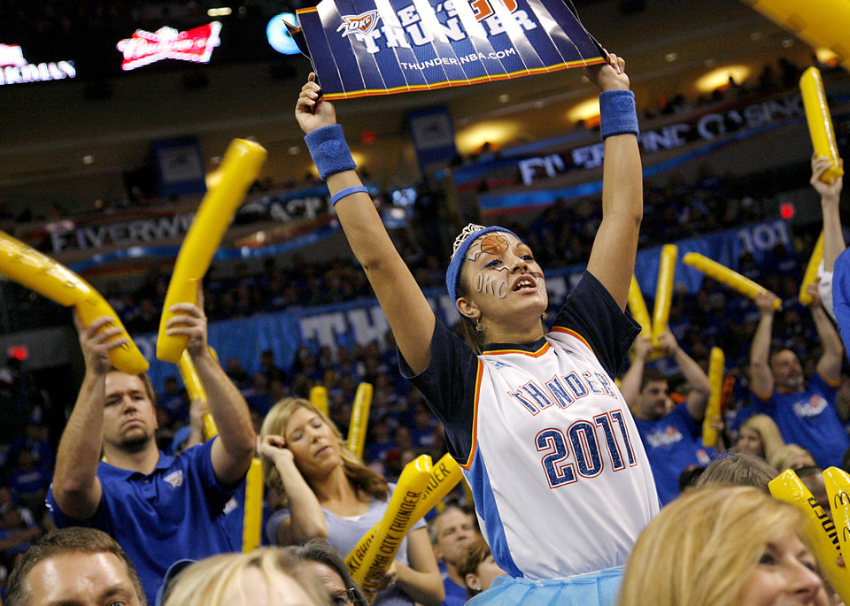 Photo - Oklahoma City fan Nauzi Jagosh cheers for the Thunder against Denver during the first round NBA Playoff basketball game between the Thunder and the Nuggets at OKC Arena in downtown Oklahoma City on Wednesday, April 20, 2011. The Thunder beat the Nuggets 106-89 and lead the series 2-0. Photo by John Clanton, The Oklahoman