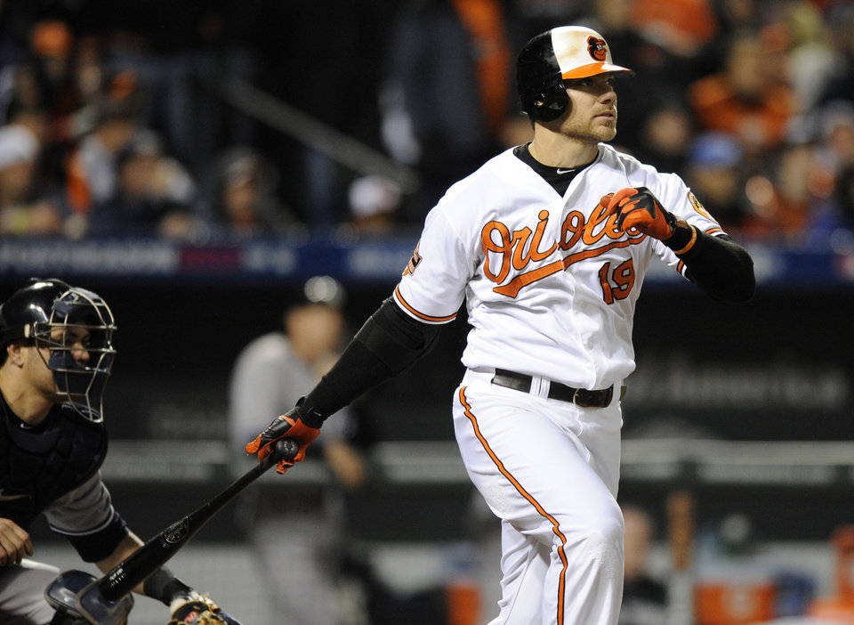 Baltimore Orioles\' Chris Davis singles in the third inning of Game 2 of the American League division baseball series against the New York Yankees on Monday, Oct. 8, 2012, in Baltimore. Robert Andino and Nate McLouth scored on the play. (AP Photo/Nick Wass)