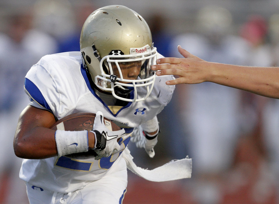 Photo - Choctaw's Corey Bennett runs the ball during a high school football game between Putnam City and Choctaw in Oklahoma CIty, Thursday, September 16,  2010.  Photo by Bryan Terry, The Oklahoman