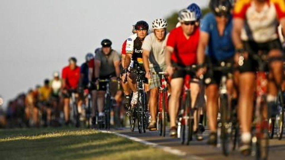 Riders head west down Britton Road on Thursday, July 22, 2010, in Oklahoma City during a memorial ride to honor  Alan  Spencer and Clyde Riggs, the cyclists who were killed last week. Photo by Bryan Terry, The Oklahoman
