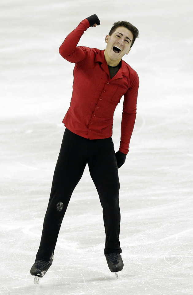 Photo - Max Aaron reacts after competing in the senior men free skate program at the U.S. figure skating championships in Omaha, Neb., Sunday, Jan. 27, 2013. (AP Photo/Nati Harnik)
