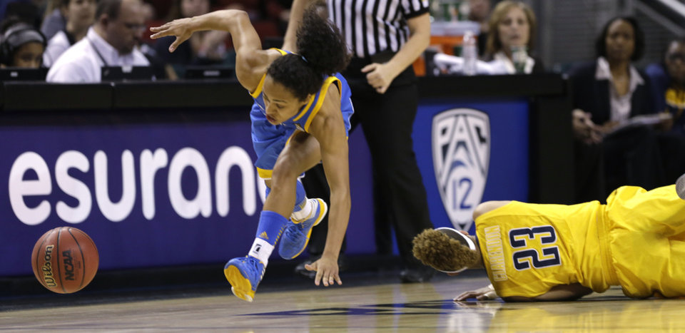 UCLA's Mariah Williams, left, stays on her feet after colliding with California's Layshia Clarendon as they chased a loose ball in the first half of an NCAA college basketball game in the Pac-12 Conference tournament Saturday, March 9, 2013, in Seattle. (AP Photo/Elaine Thompson)
