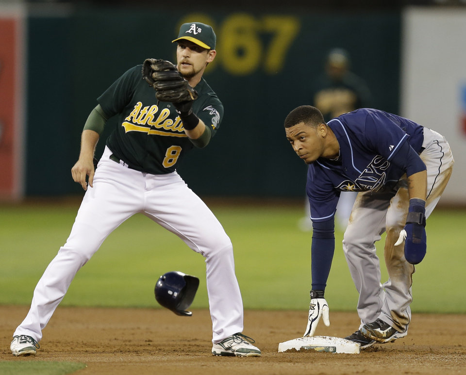 Photo - Tampa Bay Rays' Desmond Jennings, right, steals second base past Oakland Athletics' Jed Lowrie in the second inning of a baseball game Friday, Aug. 30, 2013, in Oakland, Calif. (AP Photo/Ben Margot)