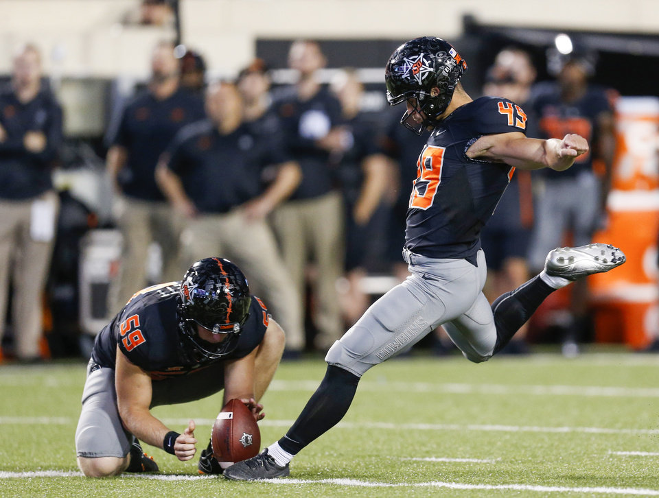 Photo - Oklahoma State's Matt Ammendola (49) kicks a field goal as Matt Hockett (59) holds in the second quarter during a college football game between Oklahoma State (OSU) and South Alabama at Boone Pickens Stadium in Stillwater, Okla., Saturday, Sept. 8, 2018. Photo by Nate Billings, The Oklahoman