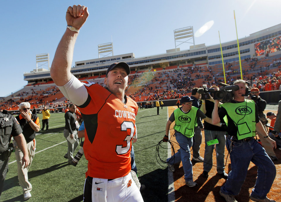 Photo - OSU quarterback Brandon Weeden (3) acknowledges the fans after the college football game between the Oklahoma State University Cowboys (OSU) and the Baylor University Bears at Boone Pickens Stadium in Stillwater, Okla., Saturday, Nov. 6, 2010. OSU won, 55-28. Photo by Nate Billings, The Oklahoman