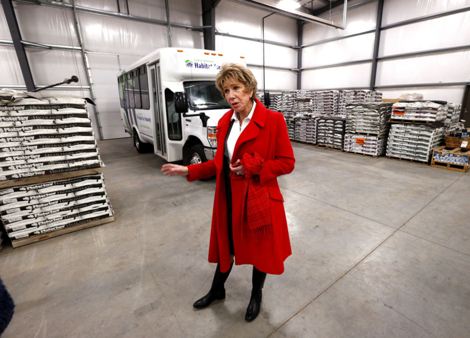 Photo -  Ann Felton Gilliland, chairman and CEO of Central Oklahoma Habitat for Humanity, walks in the warehouse at 5005 S Interstate 35 Service Road. [PHOTO BY STEVE SISNEY, THE OKLAHOMAN]
