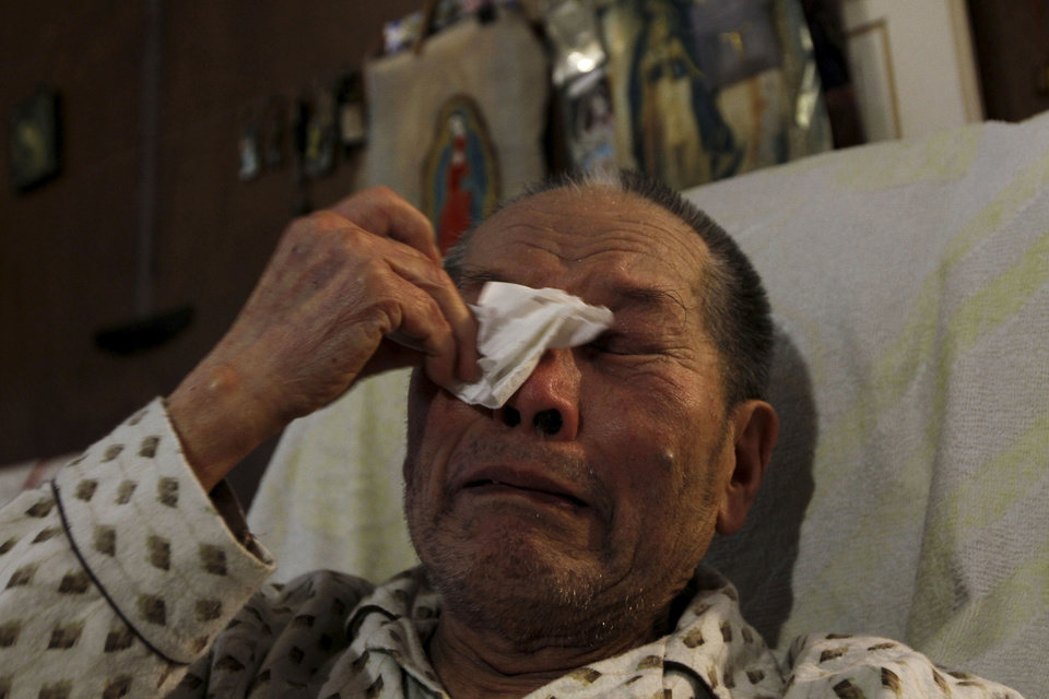 Photo -   In this photo taken Saturday, Nov. 17, 2012, Juan Chiu Trujillo, a Chinese Mexican weeps as he recounts his life story during an interview in Mexico City. Chiu who was born in Mexico, was among thousands of Chinese Mexicans expelled when Mexico erupted into xenophobia fueled by the economic turmoil of the Great Depression. Chiu returned in 1960, along with 300 other Chinese-Mexicans, after President Adolfo Lopez Mateos paid for their travel expenses and decreed that they would be legally allowed to live in Mexico. Dozens of those Chinese-Mexicans and their descendants gather Saturday, Nov. 24, 2012, at a Chinese restaurant in central Mexico City to celebrate the anniversary of their return. (AP Photo/Marco Ugarte)