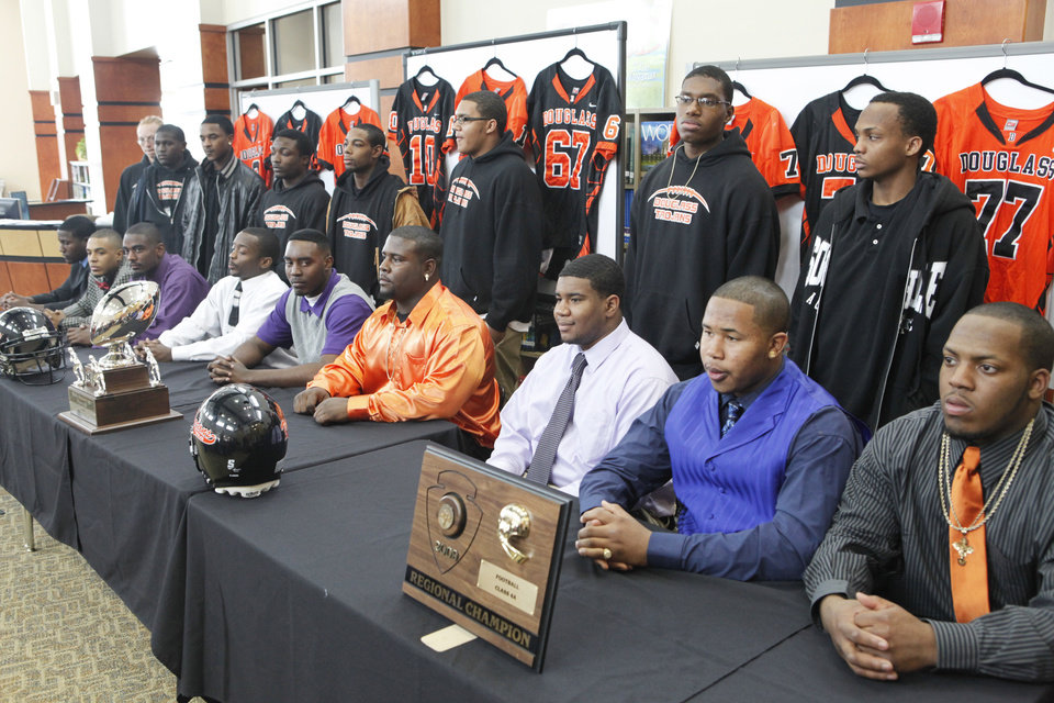Photo - NATIONAL SIGNING DAY / SIGN / LETTER OF INTENT: Senior football players pose for a photo with the signees at the Douglass High School  Signing Day ceremony, February 3, 2010.. Photo by David McDaniel, The Oklahoman ORG XMIT: KOD