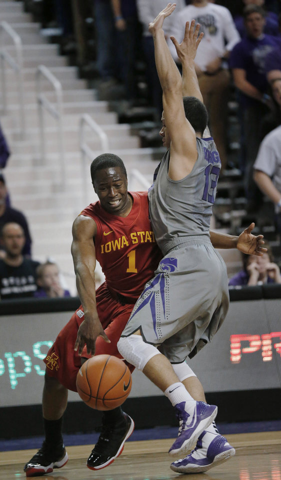 Iowa State guard Bubu Palo (1) is fouled by Kansas State guard Angel Rodriguez (13) during the first half of an NCAA college basketball game in Manhattan, Kan., Saturday, Feb. 9, 2013. (AP Photo/Orlin Wagner)